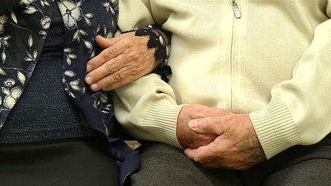 Grandmother holds the hand of the grandfather Footage