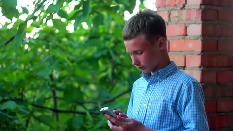 Boy with phone 1 Stock Video Footage