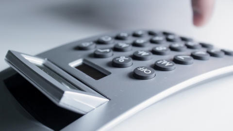 Using Electronic Calculator Stock Video Footage