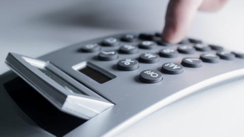 Using Electronic Calculator stock footage