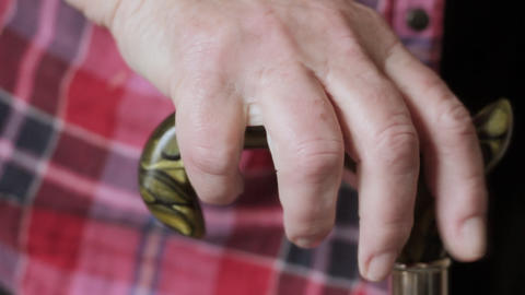 Old lady holding walking stick Stock Video Footage