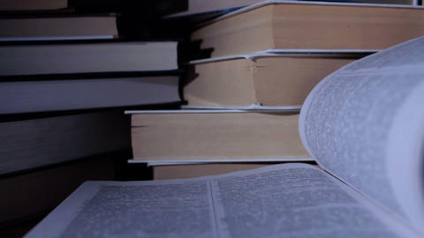 Open Book And Stack Of Closed Ones stock footage