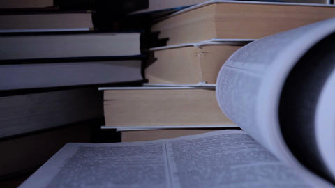 Open book and stack of closed ones Stock Video Footage