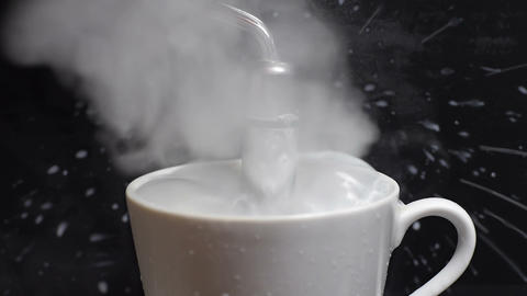 Hot milk goes out of the cup Footage