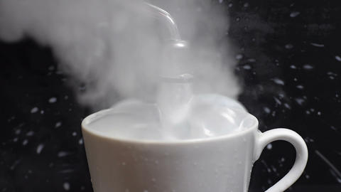 Hot milk goes out of the cup Stock Video Footage
