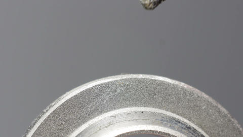 Grinding round metal part Stock Video Footage