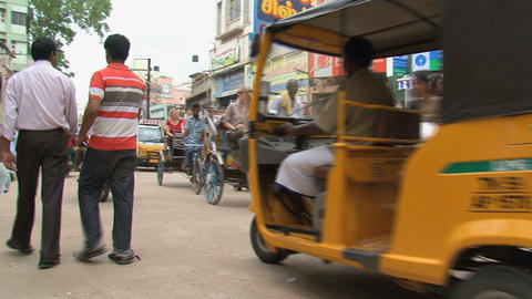 Tuk tuks, scooters and people Stock Video Footage