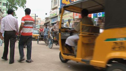 Tuk tuks, scooters and people Footage