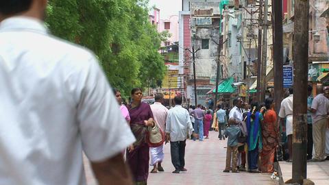 People walking in the street around The Meenakshi Stock Video Footage
