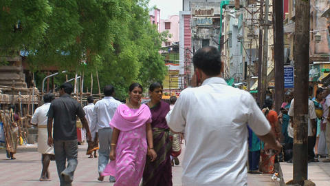 People walking in the street around The Meenakshi  Footage