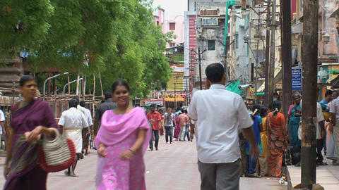 People walking in the street around The Meenakshi Stock Video Footage