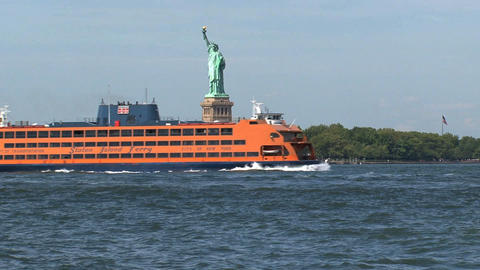 Staten Island ferry passing by The Statue of Liber Footage