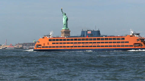 Staten Island ferry passing by The Statue of Liber Stock Video Footage
