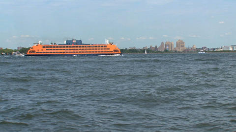 Staten Islands ferry passing by ellis island Stock Video Footage