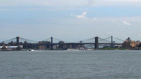 Brooklyne bridge and ferries Stock Video Footage