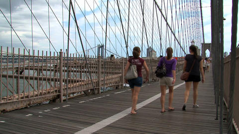 People walking and cycling on the brooklyn bridge Stock Video Footage