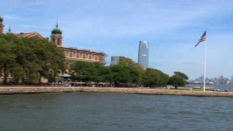 Ferry passing by ellis island on his way to manhat Footage