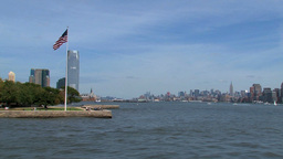 Ferry passing by ellis island on his way to manhat Stock Video Footage