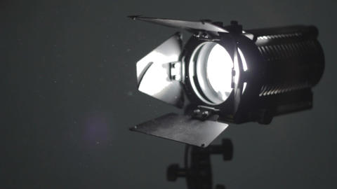 Floodlight turning on and Dust in air Stock Video Footage