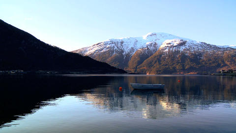 Small boat floating on crystal clear waters of a glacial... Stock Video Footage