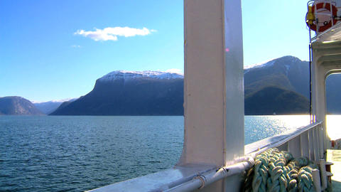 Aboard a large boat on the crystal waters of a glacial fjord Footage
