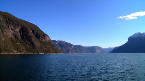Aboard a large boat on the crystal waters of a glacial fjord Stock Video Footage