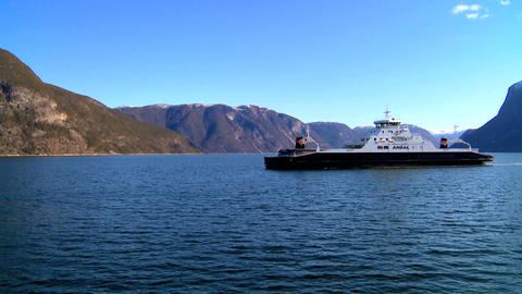 Passenger ferry on the crystal waters of a glacial fjord Stock Video Footage