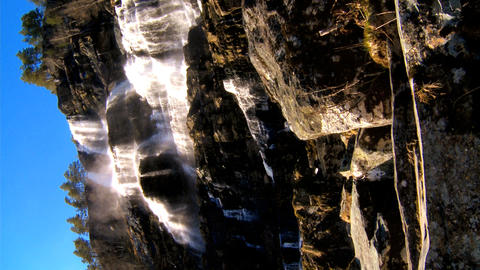 Vertical view of a powerful waterfall crashing onto rocks Footage