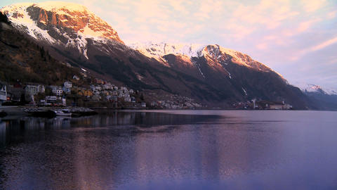 Time-lapse of hillside community & oil refinery beside glacial fjord Footage