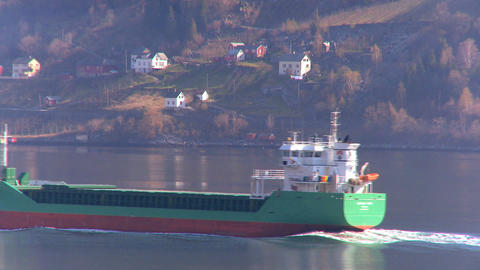 Oil tanker transporting North Sea oil along a glacial fjord Stock Video Footage