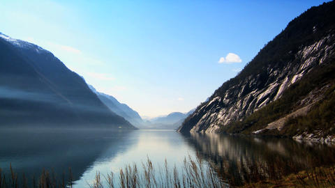Crystal clear waters & mountains of glacial fjords Stock Video Footage
