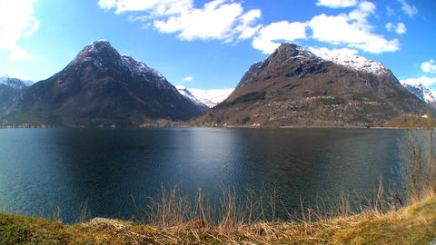 Mountains & crystal clear waters of nordic fjord Stock Video Footage
