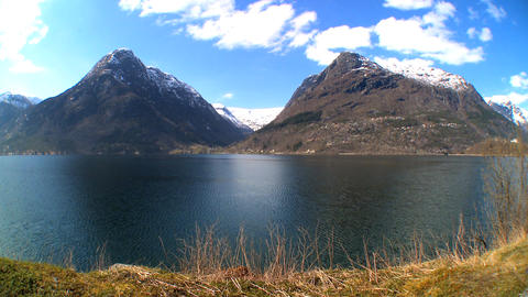 Mountains & crystal clear waters of nordic fjord Footage