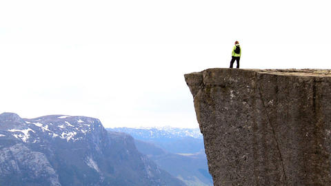 Lone young female on top of the world fulfilling her ambitions Footage