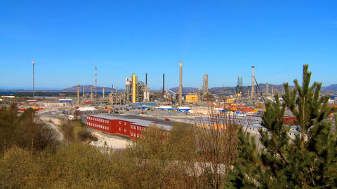 Oil refinery processing North Sea oil beside a nordic fjord Stock Video Footage