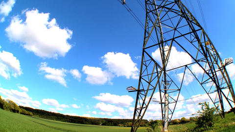 Fish-eye lens view of an electricity pylon looking skyward Stock Video Footage