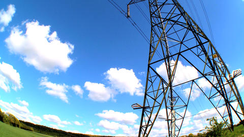 Fish-eye lens view of an electricity pylon looking skyward Footage