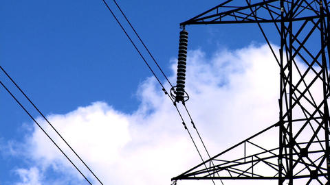 Time-lapse clouds & blue sky behind an electricity pylon Footage