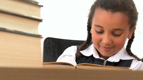 Cute african american schoolgirl early learning with a book Stock Video Footage