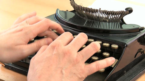 Fingers hitting the keys on an old fashioned typewriter in close-up Footage