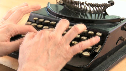 Fingers hitting the keys on an old fashioned typewriter... Stock Video Footage