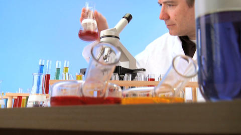 Teacher with elementary school laboratory equipment Stock Video Footage