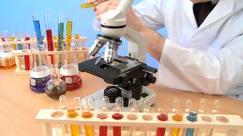 Teacher with elementary school laboratory equipment Stock Video Footage