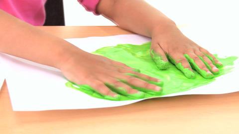 Young child early learning with hand painting Footage