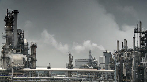Oil refinery pumping smoke into the atmosphere Footage