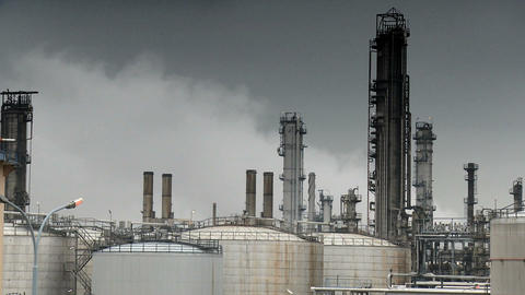 Oil refinery pumping smoke into the atmosphere Stock Video Footage