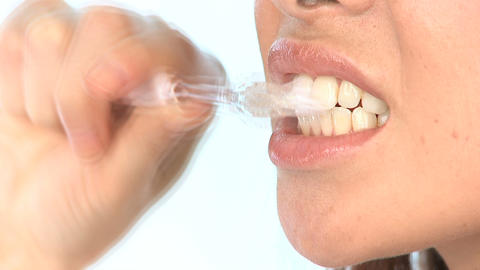 Beautiful girl showing the benefits of good dental hygiene Stock Video Footage
