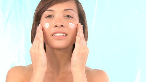 Western oriental girl showing the reward for regular skin care Footage