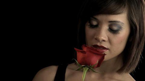 Sensuous western oriental girl in dark seductive pose Stock Video Footage