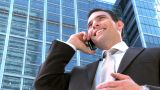 Ambitious Young City Businessman Working On A Mobile(cell) Phone stock footage